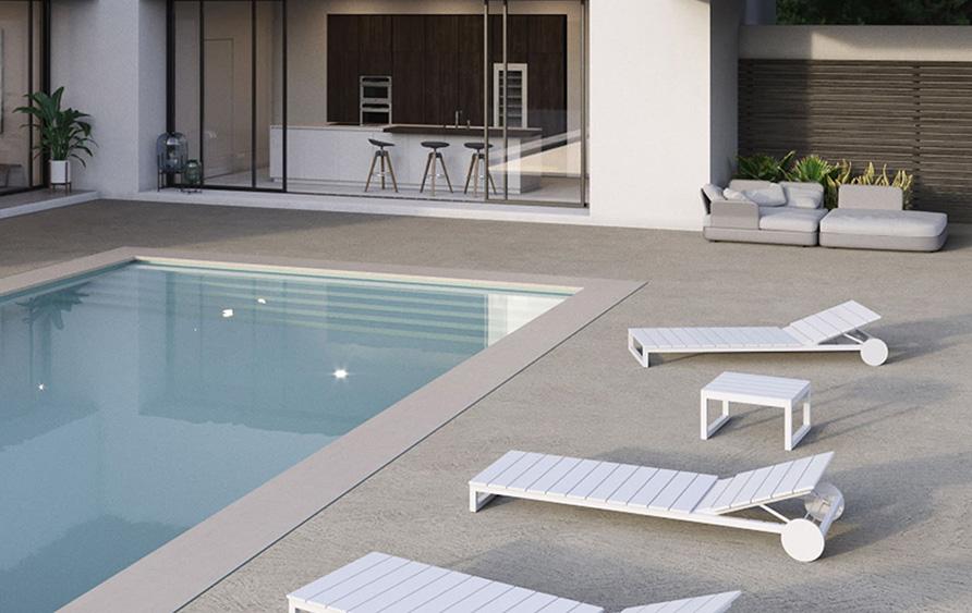 bordo piscina con pavimento in cemento spatolato